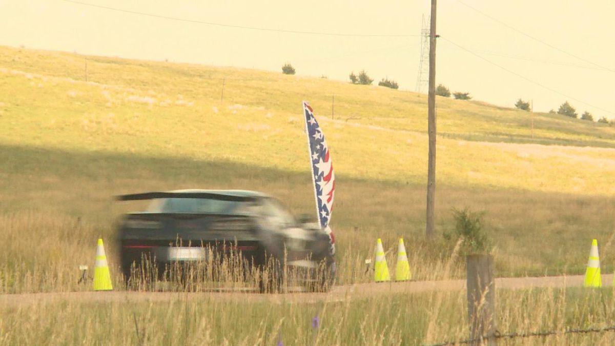 Cars zoom past onlookers at the Sandhills Open Road Challenge's One Mile Shootout on Friday.