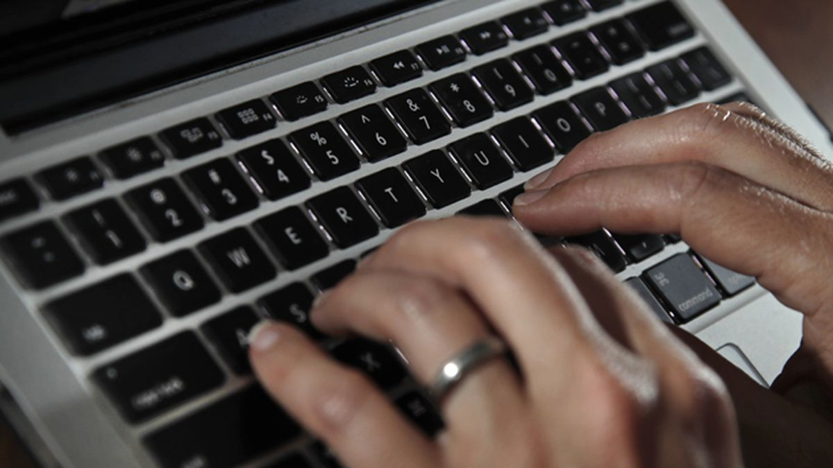 Fingers type on a laptop keyboard Monday, June 19, 2017, in North Andover, Mass. (AP...
