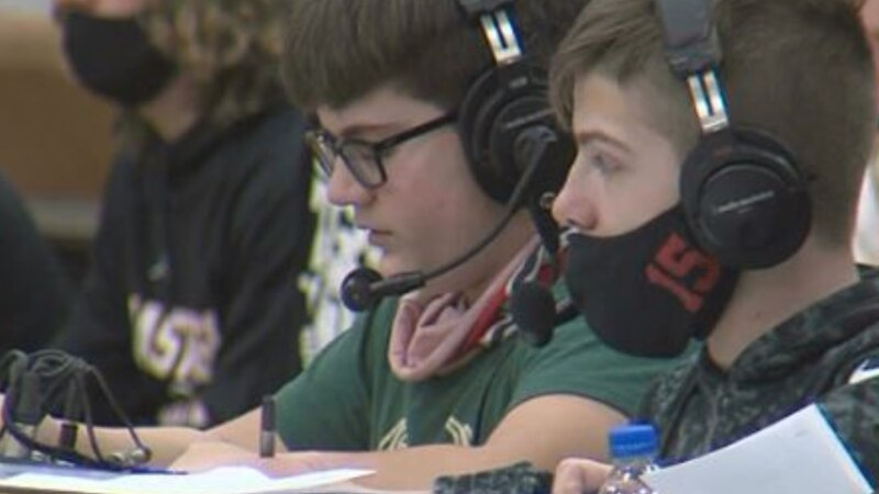 Demetri Theoharis (left) and Jack Ordegren (right) calls a Hastings High boys basketball game.
