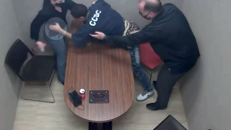 Newly released video shows 27-year-old Terrell Rhodes in an interrogation room May 11, moments...