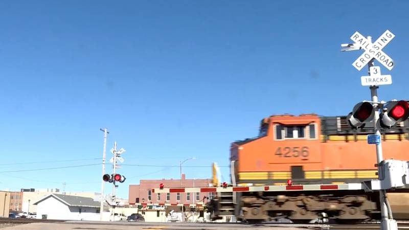 A BNSF train traveling through downtown Hastings.