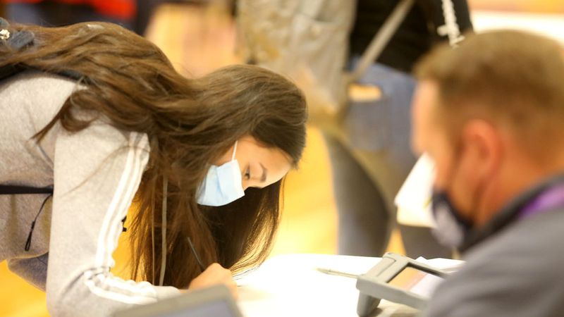 A Grand Island Senior High student attending a vaccine clinic at GISH. She is one of more than...