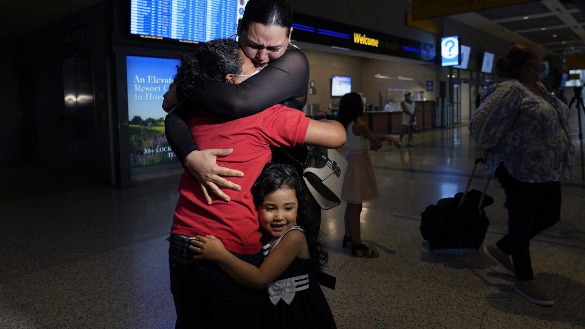 Emely, left, is reunited with her mother, Glenda Valdez and sister, Zuri, at Austin-Bergstrom...