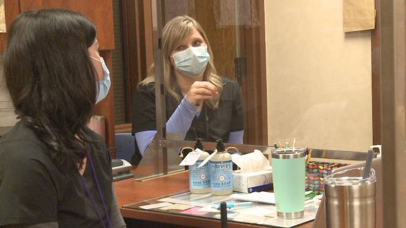 Chris Vrooman (right) will receive two awards for her work as a nurse in the Grand Island...