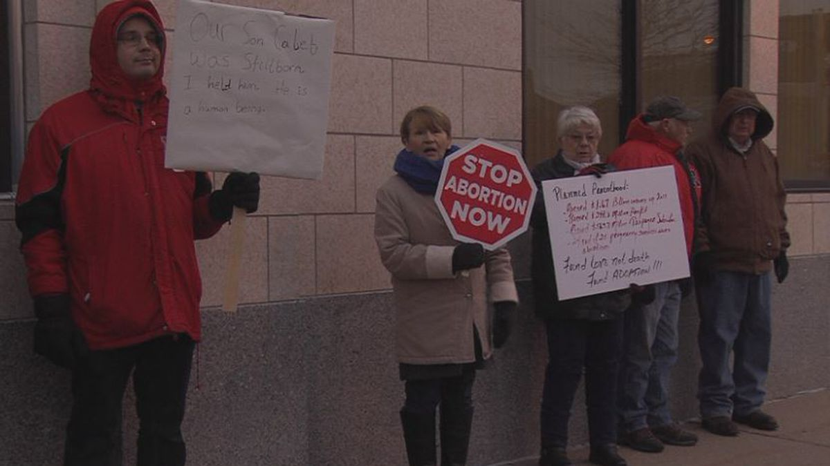 Protesters stood outside the building Planned Parenthood met in to share their concerns about their services. (Credit: Alicia Naspretto, KSNB)