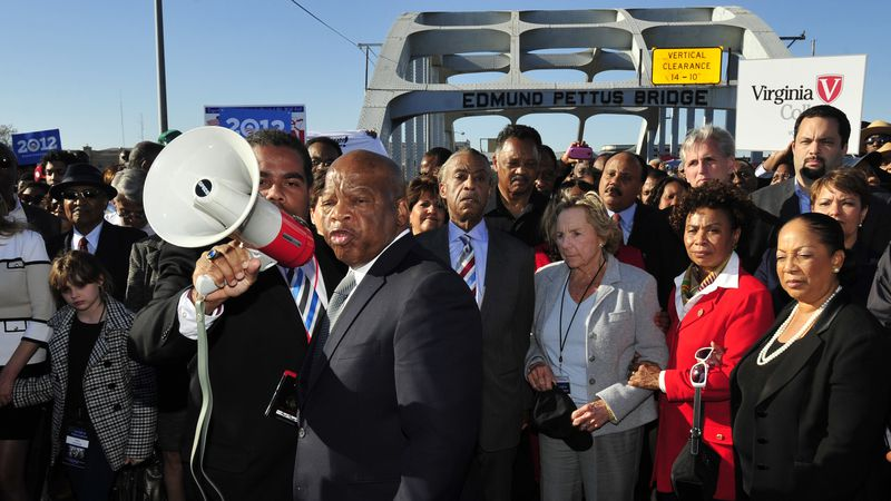 FILE - In this March 4, 2012 file photo, U.S. Rep. John Lewis, D-Ga., center, talks with those...