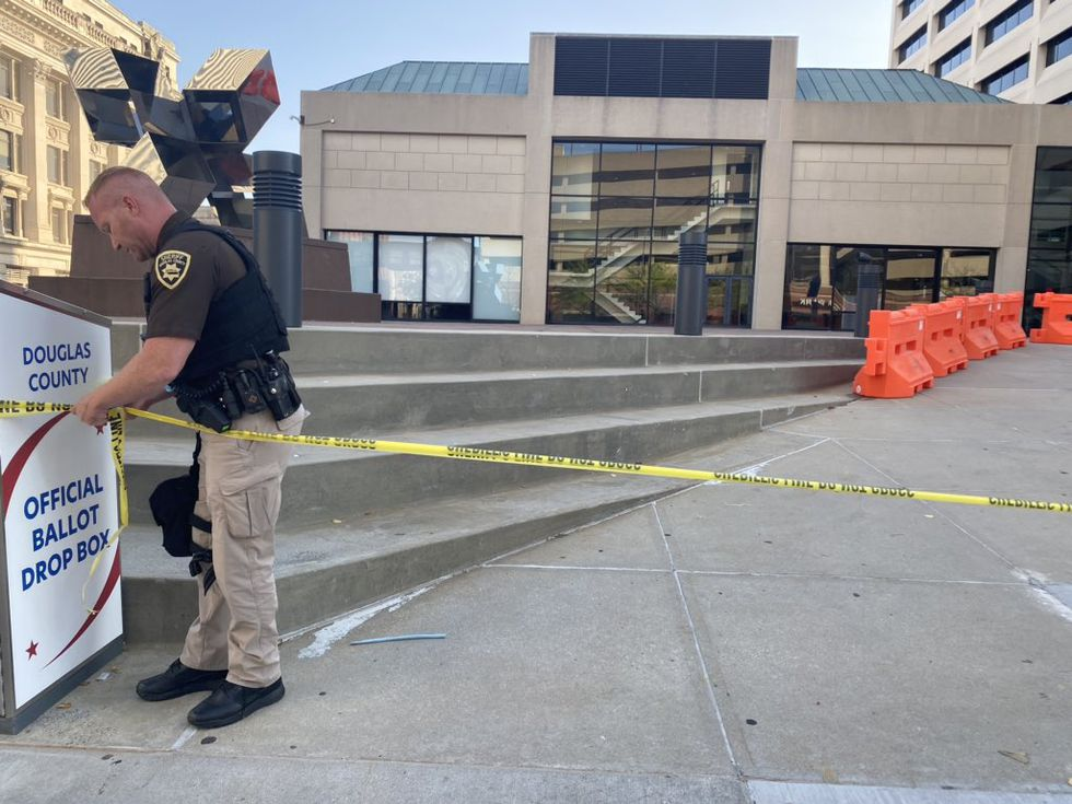 Following the announcement of the James Scurlock grand jury's indictment of Jake Gardner on Tuesday, Sept. 15, 2020, law enforcement began putting caution tape around the Omaha Civic Center.