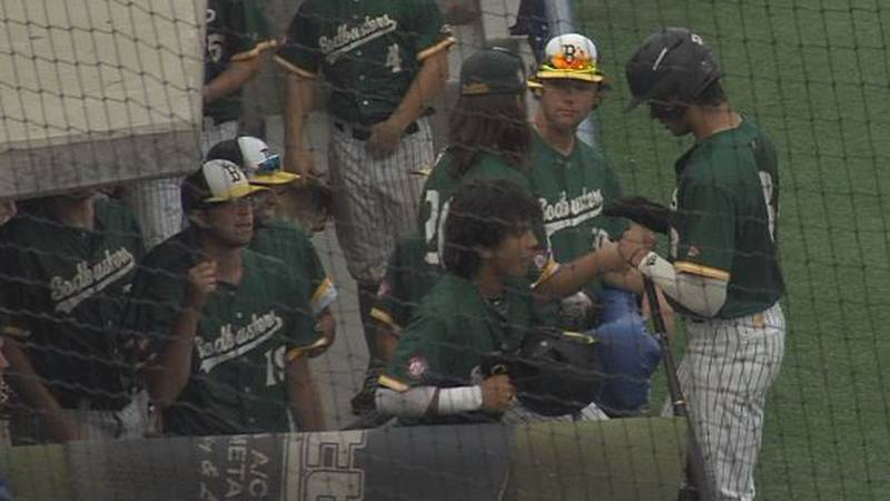 Sodbusters celebrate in the dugout