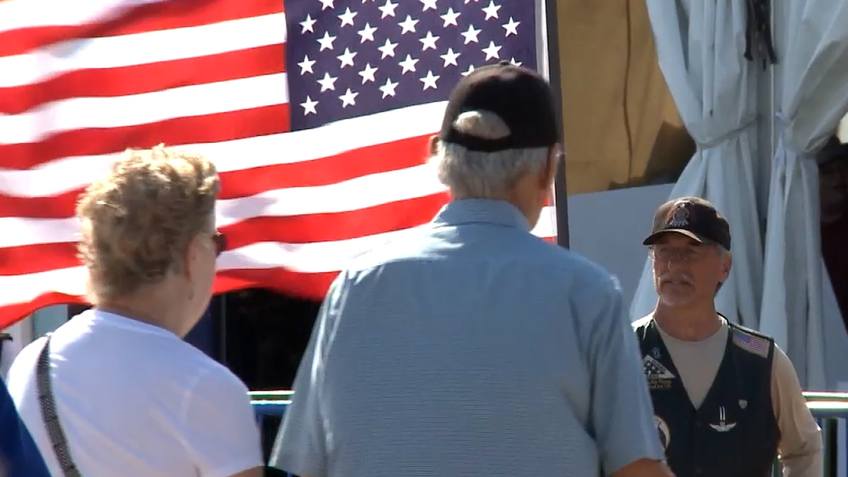 A veteran flies the American Flag prior to a State Fair recognition event.