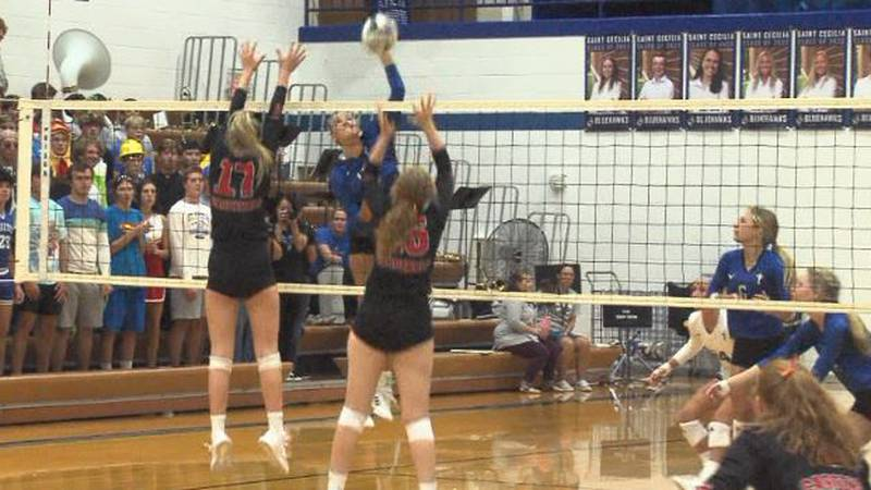 Hastings St. Cecilia's Adeline Kirkegaard goes up for a kill