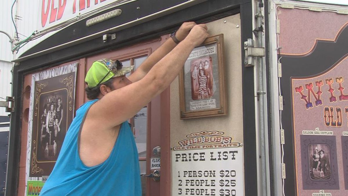 Robert Pickle puts the final touches on Wild Bob's Old Time Portraits ahead of the State Fair....