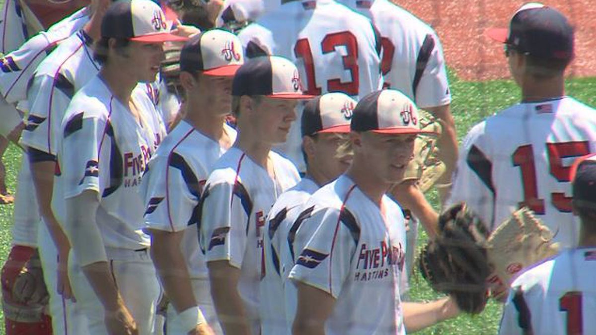 Hastings Five Points Bank line up for high fives before the game.
