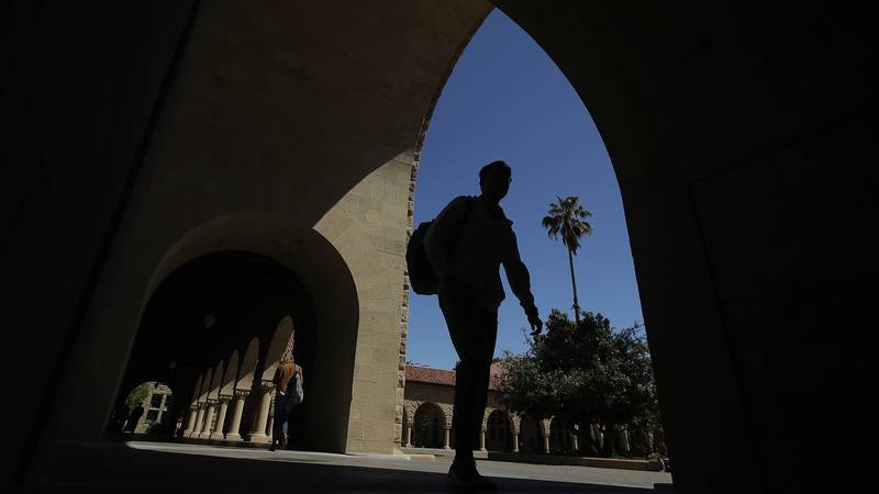 FILE - In this April 9, 2019 file photo, pedestrians walk on the campus at Stanford University...