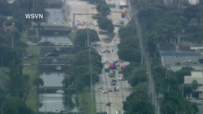A police response is seen after two officers were wounded in Doral, Fla., on Friday.