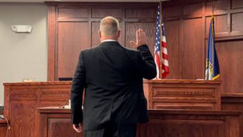 Trenton Esch swearing in for Custer County District Court Thursday.
