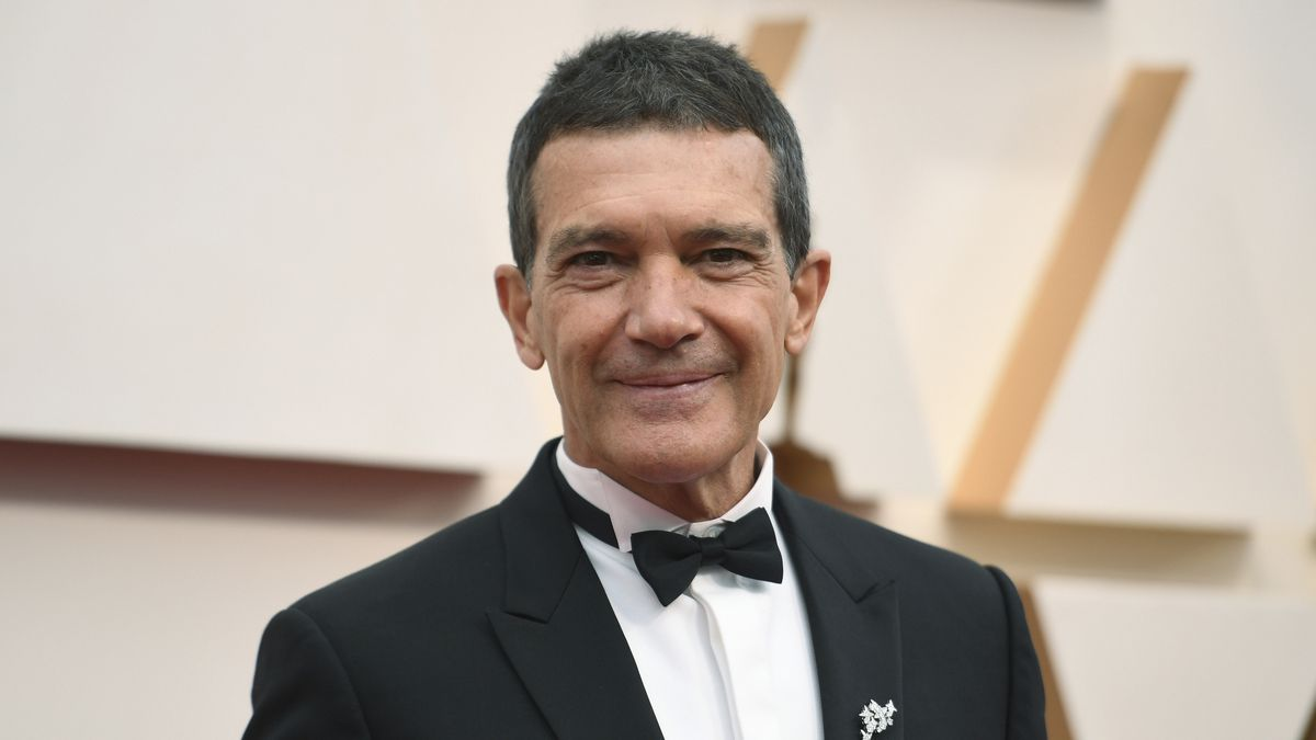 Antonio Banderas arrives at the Oscars in Los Angeles on Feb. 9, 2020. Banderas says he's tested positive for COVID-19 and is celebrating his 60th birthday in quarantine. The Spanish actor announced his positive test on Instagram on Monday.
