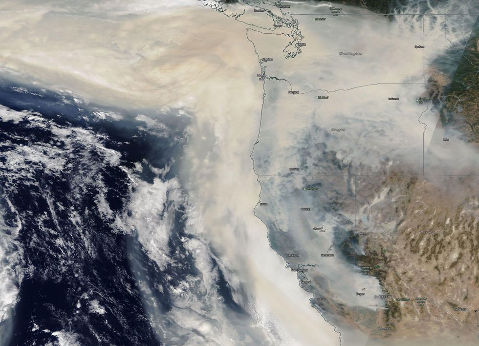 NASA imagery shows a large plume of smoke out over the Pacific Ocean from wildfires in California and Oregon. This image is from 12 September, 2020.