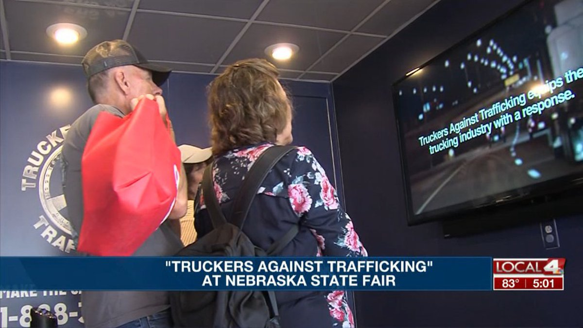People look at the stories of human trafficking victims at the Truckers Against Trafficking's...