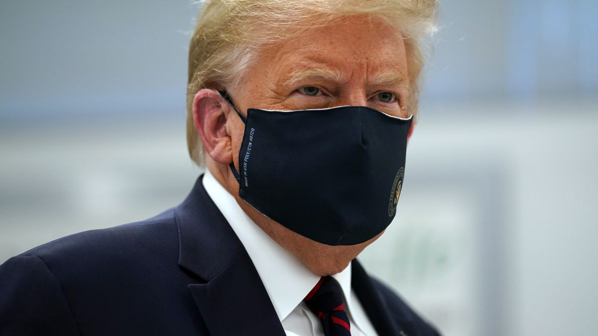 President Donald Trump wears a face mask as he participates in a tour of Bioprocess Innovation Center at Fujifilm Diosynth Biotechnologies, Monday, July 27, 2020, in Morrisville, N.C.