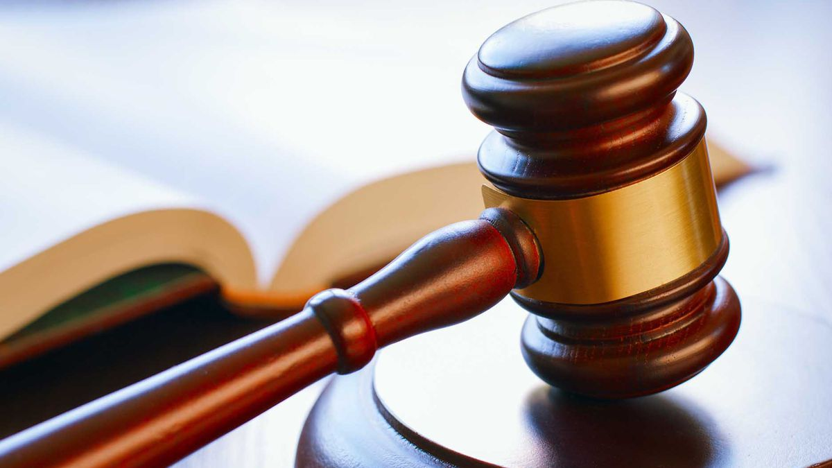 A former Minden School Board member has been formally charged for not wearing a mask.