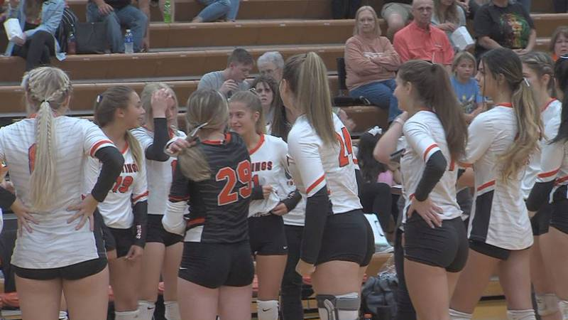 Hastings High volleyball in a huddle.