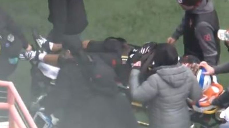 Collin Miller as he was carried off on a stretcher.