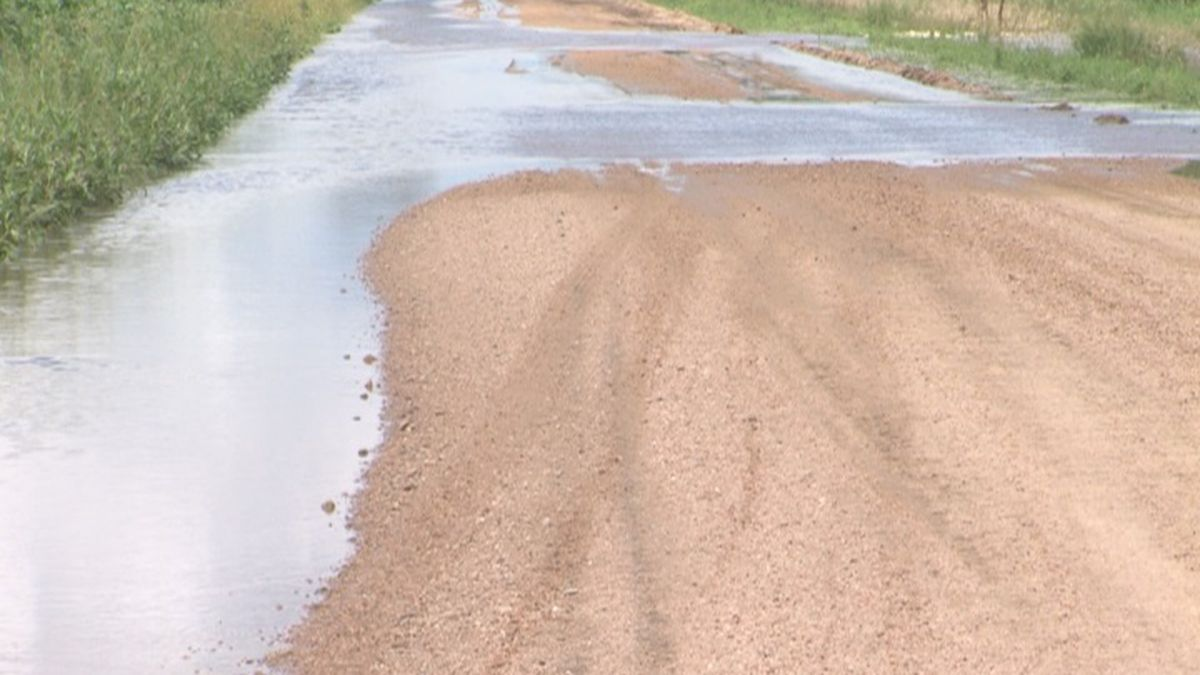 Road near Edgar is covered in water after heavy rains.
