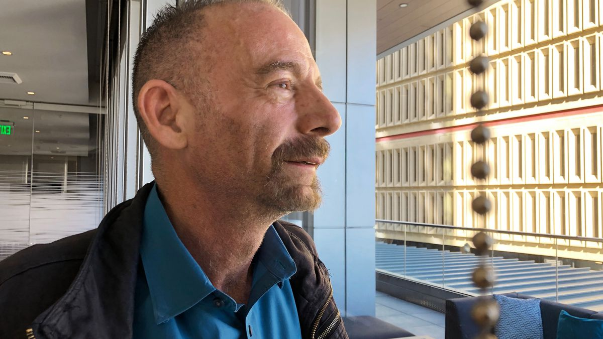 "FILE - This March 4, 2019 file photo shows Timothy Ray Brown in Seattle. Brown, who made history as ""the Berlin patient,"" the first person known to be cured of HIV infection, died Tuesday, Sept. 29, 2020, at his home in Palm Springs, Calif., according to a social media post by his partner, Tim Hoeffgen. He was 54. The cause was a return of the cancer that originally prompted the unusual bone marrow and stem cell transplants Brown received in 2007 and 2008, which for years seemed to have eliminated both his leukemia and HIV, the virus that causes AIDS."