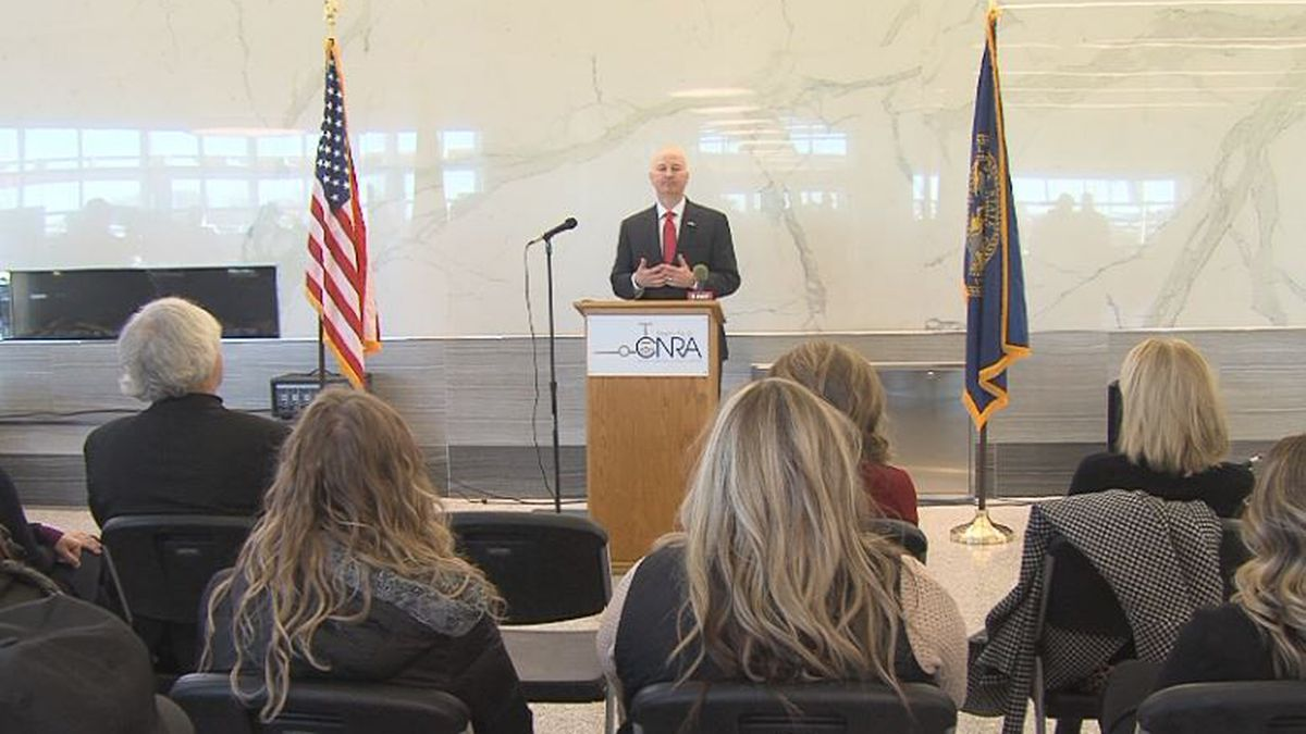 Gov. Pete Ricketts speaks in front of a crowd at the Grand Island airport just a few hours after delivering State of the State address. (Credit: Alicia Naspretto, KSNB)