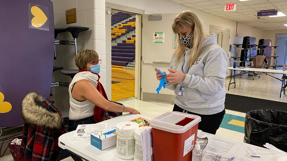 A Grand Island Senior High staff member getting a COVID-19 vaccination Friday morning.