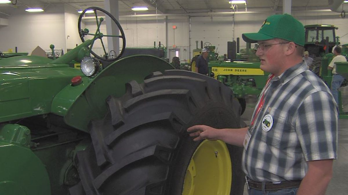 Classic Green Reunion Exhibitor Ethan Byrum shows off new tires he put on his refurbished John...