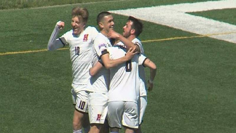 Hastings College players celebrate a goal