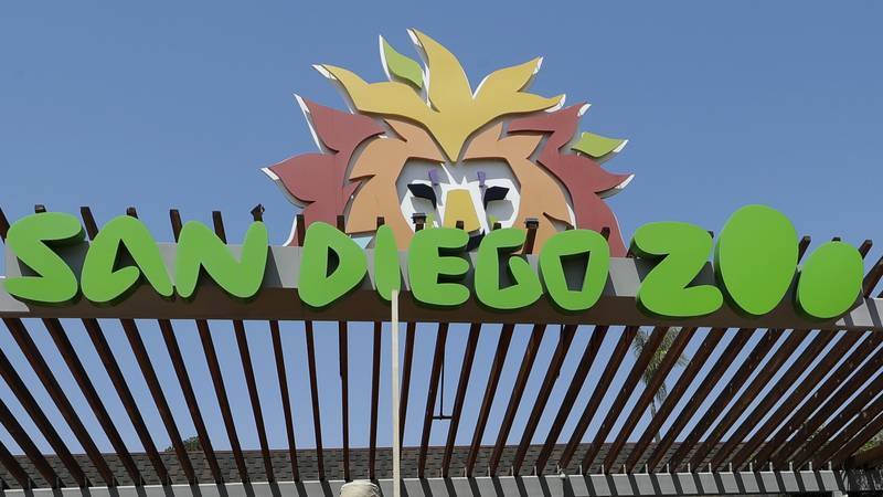 In this June 11, 2020, file photo, a sign is near the entrance to the San Diego Zoo in San Diego.