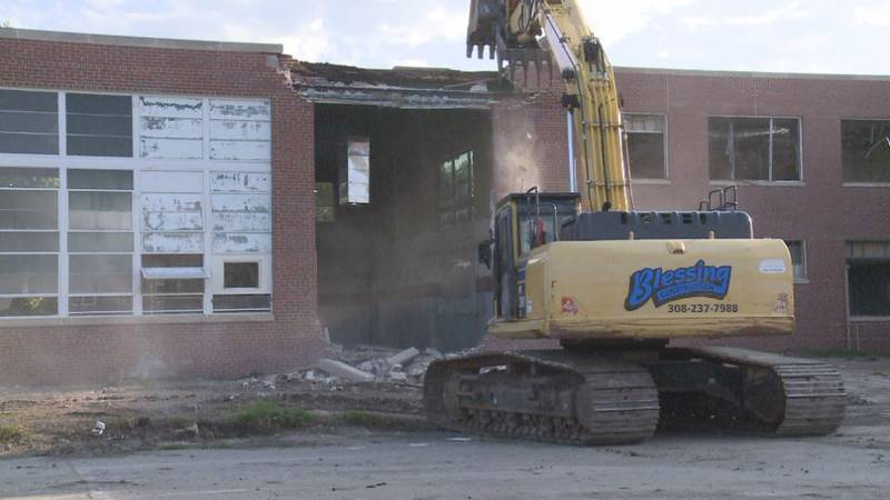 Demolition crew working to knock down the Otto Olsen building on the UNK campus.