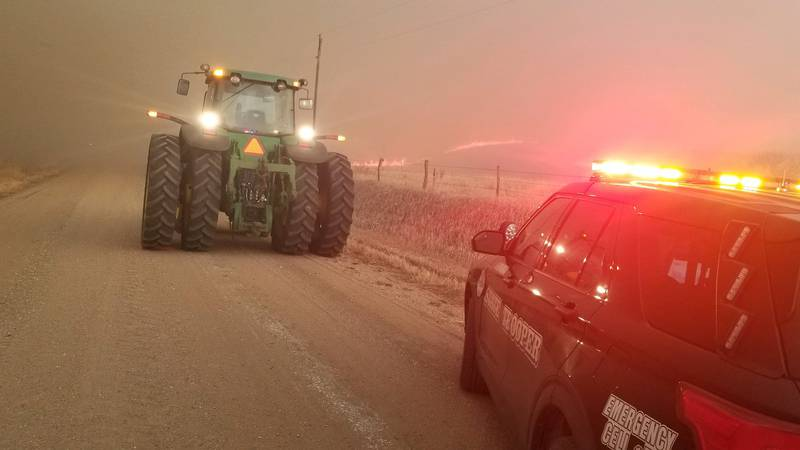 Smoke from a grass fire burning in Webster and Nuckolls counties cut visibility on a gravel road.