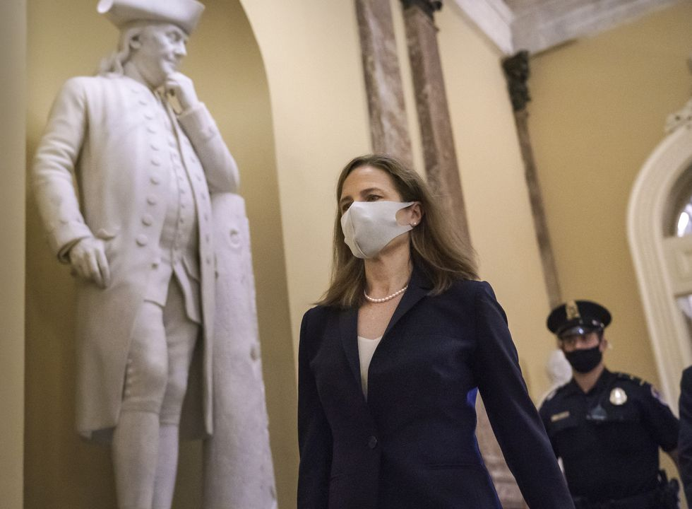 Judge Amy Coney Barrett, President Donald Trump's nominee for the Supreme Court, arrives for...