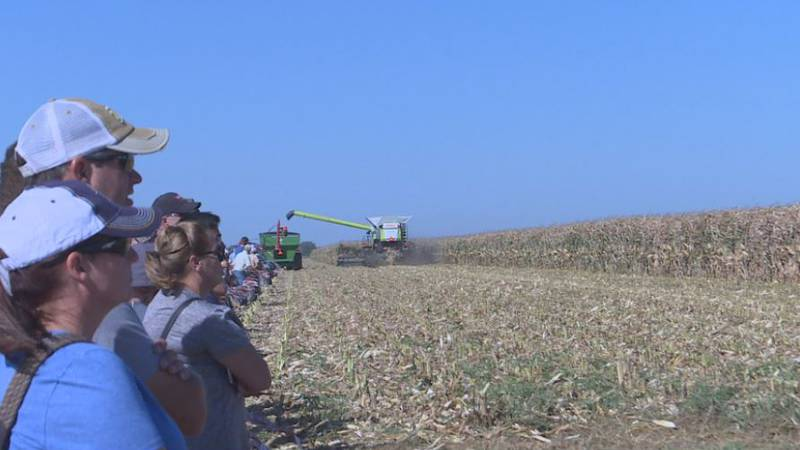 A crowd gathers alongside the Husker Harvest Days field, where various farm equipment and...
