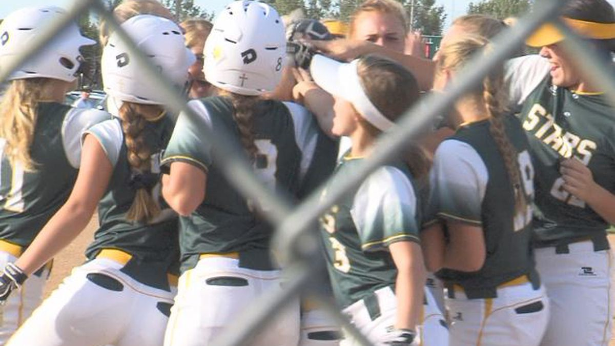 Kearney Catholic celebrates a home run in the 6th inning.