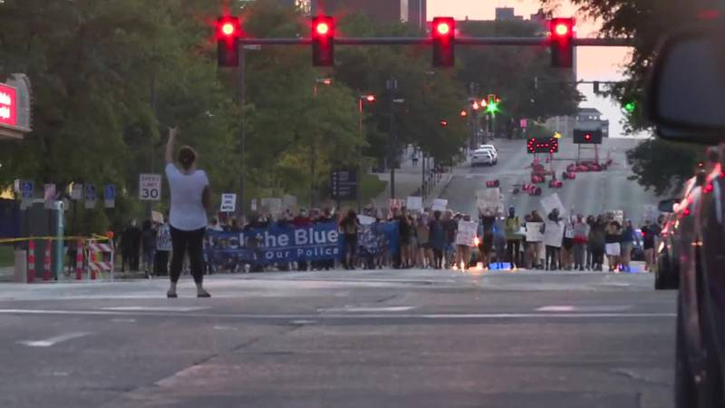 A group of protesters, organizing on social media, gathered Saturday evening, July 25, 2020,...