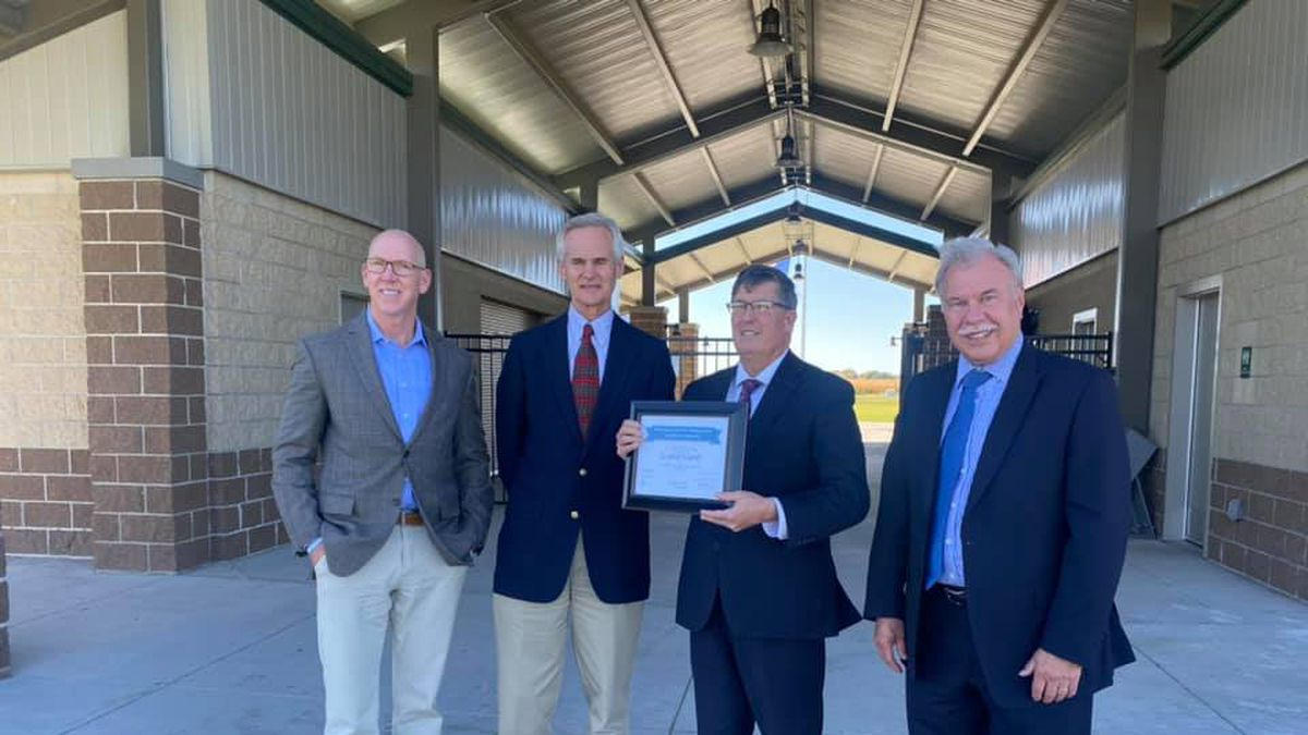 President of the Grand Island Area Economic Development Dave Taylor, Lieutenant Governor Mike Foley, Mayor Roger Steele and City Administration Jerry Janulewicz pose together with Nebraska Economic Development Certified Community plaque.