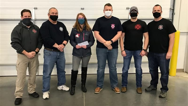 Local4's Shannon Heckt shown here with members of the Grand Island firefighters union. She was...
