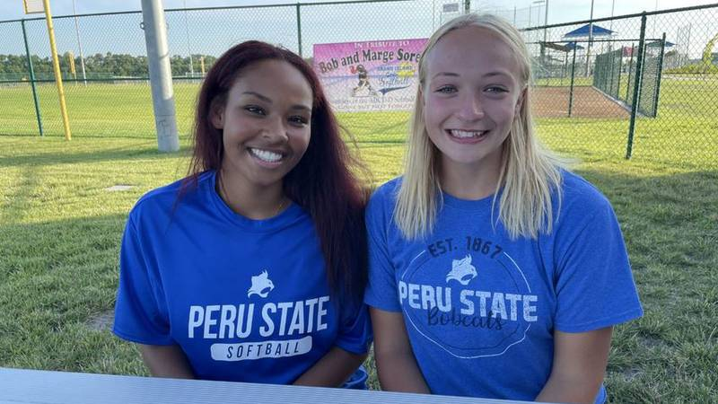 Childhood friends both sign to play softball at Peru State