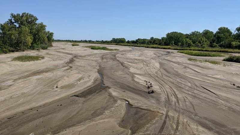 As water levels fall, some shallow channels of the Platte River are drying up after a near...
