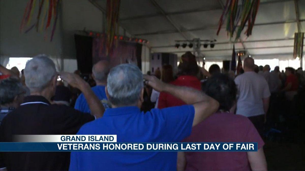 Veterans salute the flag during a morning memorial. (Credit: KSNB)