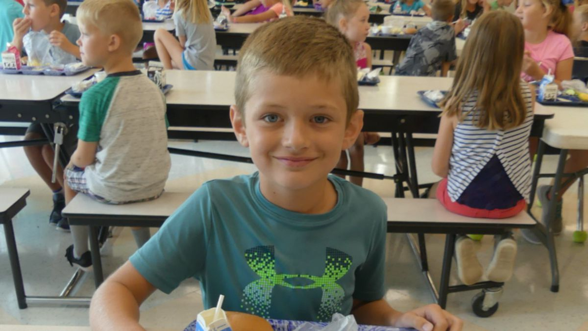 Kearney student Emmett Clay having lunch at Meadowlark Elementary school.  A USDA program will provide free lunches to KPS students this fall.