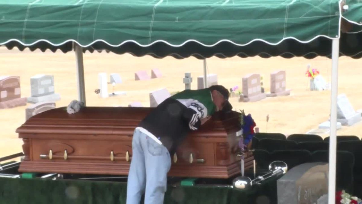 Family members say goodbye to Donald Stratton, a World War II veteran and Pearl Harbor...