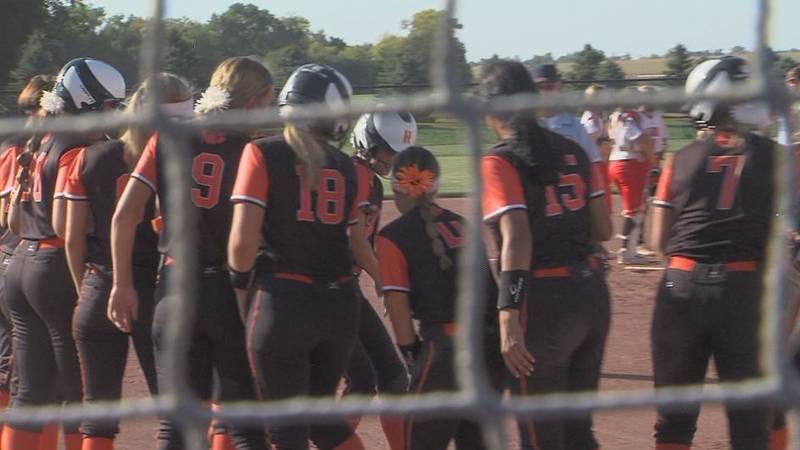 Hastings softball hits a home run against Aurora.