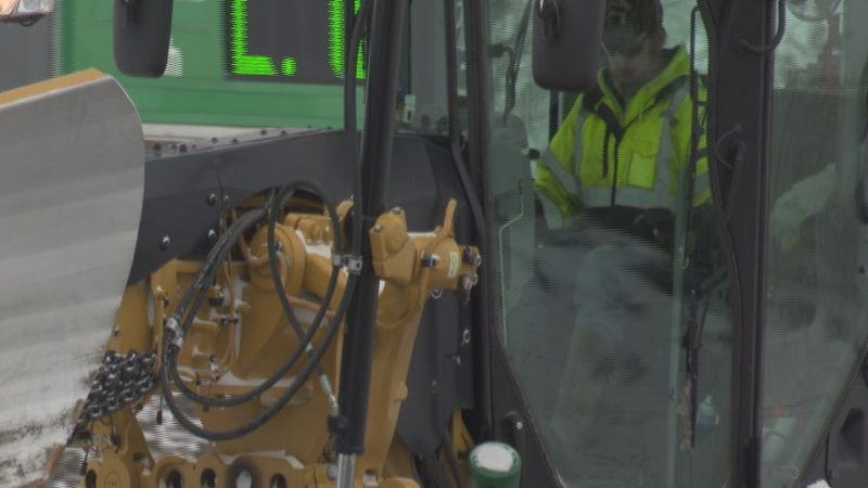 Hall County Street Department staff works to clear snow off roads.
