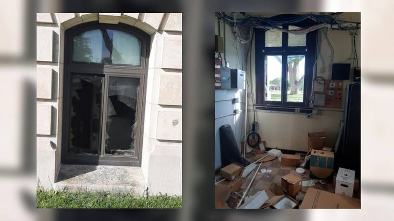 Broken glass and boxes strewn around at the Hall County Courthouse after a deer jumped threw a...