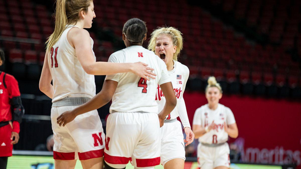 Nebraska women's basketball players celebrate their win over Rutgers.